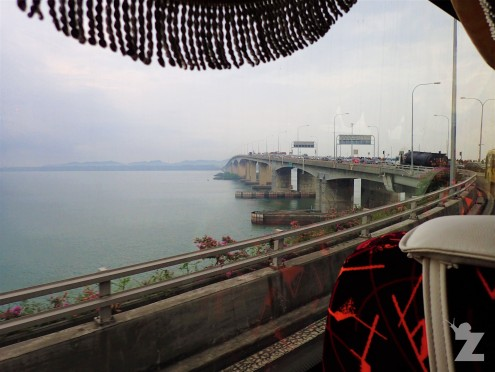 In the bus, crossing the bridge to Malaysia from Singapore