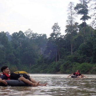 Lam and Tom tubing down the Endau River