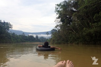 Shima and I tubing down the Endau River