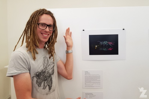 "Tom with his entry ""Ruby-tailed Wasp"" at the Gallery on Guyton, Whanganui, New Zealand"