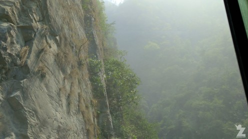 The sheer cliff faces above and below the road